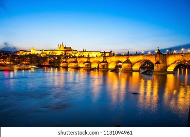 Charles bridge with water reflection, Prague, Czech Republic. A well-known tourist and historical attraction. Medieval architecture of Europe