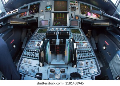 Charles de Gaulle airport, Paris / France - 08.21.2018. Cockpit of jet passenger aircraft Airbus A320. Throttle and dashboard closeup.