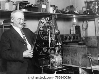 Charles Francis Jenkins, American inventor, engineer, and television pioneer. He is inspecting the apparatus to broadcast motion pictures by radio in 1928, aka televison