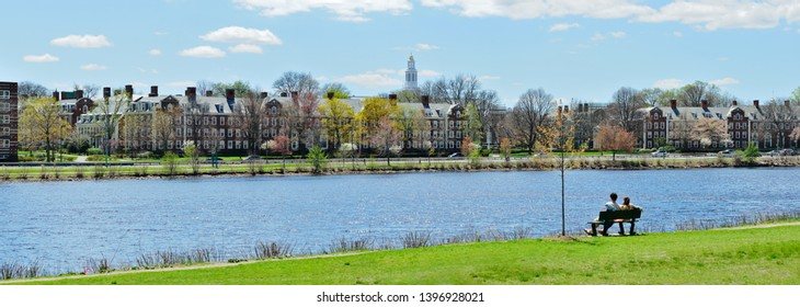 Charles River in early spring, panoramic view. Harvard University buildings and colorful tree flower in the background.