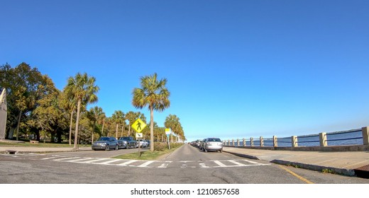 CHARLESTON, SC - APRIL 7, 2018: City oceanfront with tourists on a sunny day. The city attracts 10 million tourists annually.