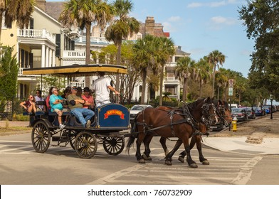 CHARLESTON, SC - OCT 03, 2017: Horse-drawn carriage touring the streets of historic Charleston South Carolina.