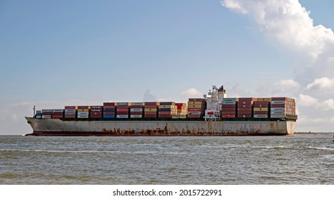CHARLESTON, SC, USA - JULY 27, 2021: Porto Kagio, a 279-meter container vessel operated by Israeli shipping company ZIM and flagged to Liberia, sails out of Charleston Harbor.