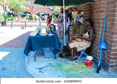 Charleston, SC, USA June 23, 2010 A craftswoman creates stunning sweetgrass baskets in Charleston, South Carolina, using traditional methods and techniques handed down through generations