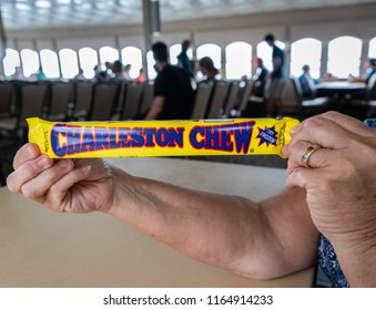 CHARLESTON, S.C./U.S.A. - JULY 27, 2018:A photo of a Charleston Chew candy bar being held by a woman on a Fort Sumter-bound ferry boat.