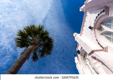 Charleston, South Carolina, USA - Nov. 29, 2019: Know as the Holy City, Charleston is known for its churches. Here, architectural details of the pink stucco Huguenot French Protestant Church are seen.