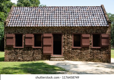 """CHARLESTON, South Carolina/U.S.A. - JULY 29, 2018: A photo of a""""Slave Street,"""" preserved brick cabins on the Boone Plantation. The plantation is one of America's oldest working farms."""