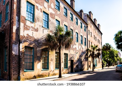 Charleston, USA - May 12, 2018: Downtown district in city with residential street in South Carolina with cars and people in southern town multicolored houses