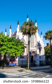 Charleston, USA - May 12, 2018: Old town downtown district in South Carolina city with French huguenot protestant church revival gothic architecture with palm trees