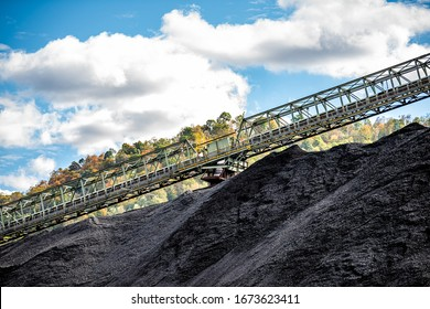 Charleston, West Virginia, USA city with black coal mound and industrial factory conveyor belt power plant exterior architecture with elevator lift