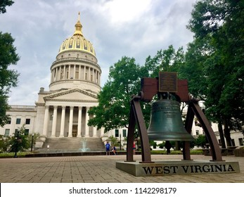 Charleston, West Virginia, USA - July 24, 2018: Tourists visit the grounds of the West Virginia Capitol Complex on a late summer afternoon.
