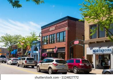Charlevoix, Michigan - June 21, 2018: Bridge Street with many upscale shops across the Charlevoix Marina