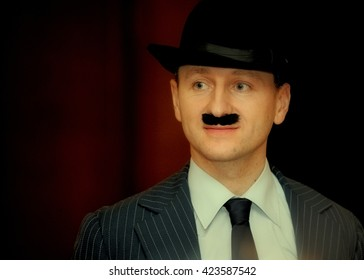 Charlie chaplin lookalike in bowler and with moustache at carnival