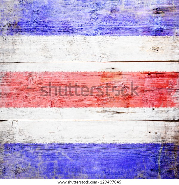 Charlie, international maritime signal flag painted on grungy wood plank background