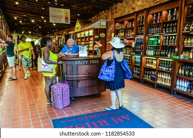 Charlotte Amalie, St. Thomas, US Virgin Islands / USA - October 1, 2013: Tourists shopping at a duty free liquor store in Charlotte Amalie on the island of St. Thomas in the U.S.Virgin Islands.