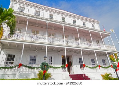 CHARLOTTE AMALIE, ST THOMAS, US VI - DECEMBER 18: Government house facade in Christmas decorations in Charlotte Amalie on December 18, 2014. The house balcony has beautifully intricate ironwork.