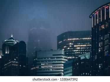 Charlotte city skyline on a misty foggy night with glowing lights