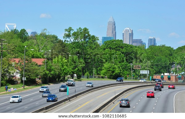 Charlotte, NC / 04/28/2018- Light traffic flows toward and away from downtown Charlotte on a sunny day.