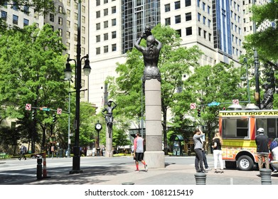 Charlotte, NC/ 04/28/2018- Visitors and locals explore the area known as The Square at Tryon and Trade streets.