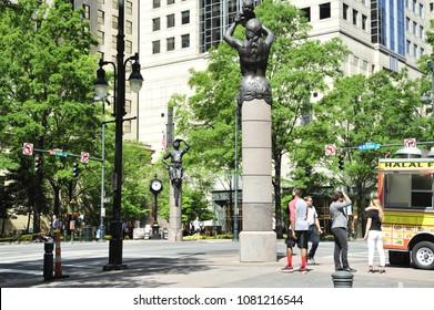 Charlotte, NC/ 04/28/2018- Visitors and locals wander around The Square on Tryon and Trade in Uptown Charlotte.