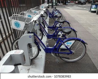 CHARLOTTE, NC - APRIL 2014: Rack of Bicycles in downtown Charlotte, North Carolina. Part of the Charlotte B-Cycle bike sharing program, in partnership with Blue Cross Blue Shield of North Carolina.
