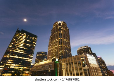 Charlotte, NC - July 10, 2019: Partial downtown Charlotte skyline at night, looking up towards the sky.