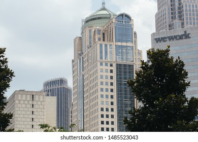 Charlotte, NC - July 10, 2019: WeWork and other high rise buildings in downtown Charlotte on a cloudy day.