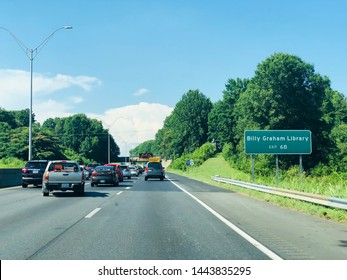 Charlotte, NC - July 2, 2019: Highway 77 in the city of Charlotte with Billy Graham Library sign Exit 6B to the right.