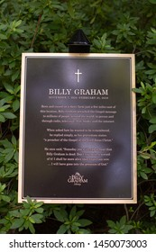 Charlotte, NC - July 4, 2019: The plaque seen at the late Billy Grahams tomb near the Library which serves as a museum and a tour of mans' life.
