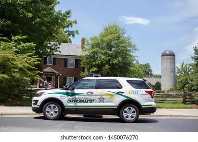 Charlotte, NC - July 4, 2019: Mecklenburg Sherrif car parked near the Billy Graham Library.