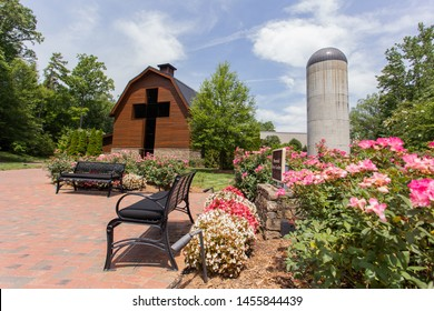 Charlotte, NC - July 5, 2019: Billy Graham Library from the rose garden on a sunny warm summer day.