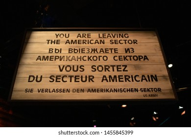 """Charlotte, NC - July 5, 2019: German Nazi poster stating that """"You are leaving the American Sector"""" seen inside Billy Graham Library."""