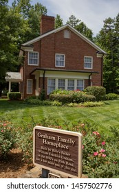 Charlotte, NC - July 5, 2019: Homeplace of Graham Family where young Bill Graham grew up as a child. Focus on plaque.