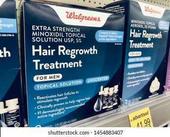 Charlotte, NC - July 6, 2019: A box of Hair Regrowth Treatment for Men at Walgreens store.