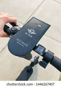 Charlotte, NC - July 8, 2019: Close up of the control panel on a BIRD scooter with QR code and acceleration knob visible.