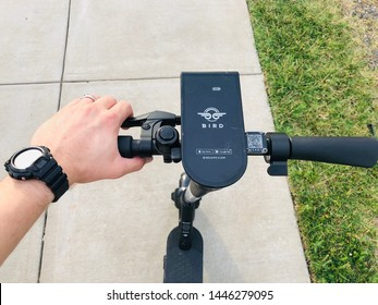 Charlotte, NC - July 8, 2019: Steering column of an electric BIRD scooter on a sidewalk in downtown.