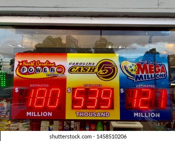Charlotte, NC - July 8, 2019: North Carolina Powerball Lottery and Mega Millions estimated display of dollars up for grabs. Posted on a convenience store.