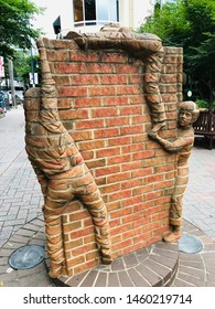 Charlotte, NC - July 9, 2019: Piece of brick art at this petite literary themed park known as The Green in downtown Charlotte.