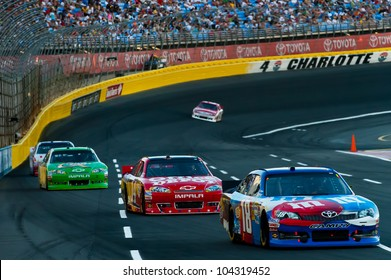 CHARLOTTE, NC - MAY 27: Kyle Busch leads Tony Stewart and Kasey Kahne  at the Nascar Coca Cola 600  at Charlotte Motorspeedway in Charlotte, NC on May 27, 2012