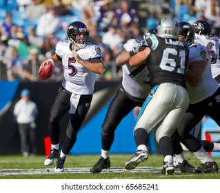 CHARLOTTE, NC - NOV 21, 2010:  Baltimore Ravens quarterback Joe Flacco scrambles as the Carolina Panthers play the Baltimore Ravens on Nov 21, 2010 at Bank of America Stadium in Charlotte, NC.