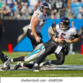CHARLOTTE, NC - NOV 21:  Baltimore Ravens quarterback Joe Flacco gets sacked as the Carolina Panthers play the Baltimore Ravens on Nov 21, 2010 at Bank of America Stadium in Charlotte, NC.