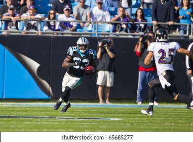 CHARLOTTE, NC - NOV 21: Carolina Panthers running back Mike Goodson (33) returns a ball as the Carolina Panthers play the Baltimore Ravens on Nov 21, 2010 at Bank of America Stadium in Charlotte, NC.