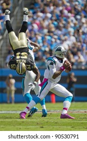 CHARLOTTE, NC - OCT 09, 2011:  Saints Linebacker, Jonathan Vilma, is flipped while Panthers Quaterback, Cam Newton, sets up to pass at Bank of America Stadium in Charlotte, NC on Oct 9, 2011.