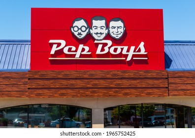 """Charlotte, NC USA - 04 27 2021:  Horizontal, medium shot of """"Pep Boys"""" auto service signage on facade of store, showing brand and logo in bright red and white above front windows."""