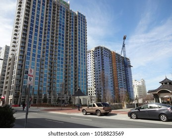 CHARLOTTE, NC / USA - APRIL 2014: Large high-rise complexes going up in downtown Charlotte, North Carolina. Cranes hover in the sky during construction phase.