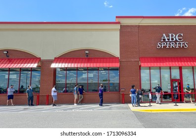 Charlotte, NC, USA - April 24, 2020: Retail liquor store and customers practicing social distancing  during the corona virus pandemic.