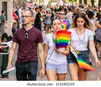 Charlotte, NC / USA - August 18, 2019: People walking the streets of Charlotte in support of the LGBTQ community during the 2019 Bank of America Charlotte Pride Parade in Charlotte, NC.