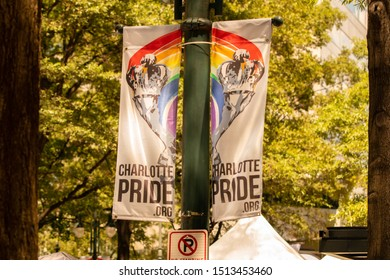 Charlotte, NC / USA - August 18, 2019: Two banners with the Charlotte Pride website hang from a light post at the 2019 Bank of America Charlotte Pride Parade