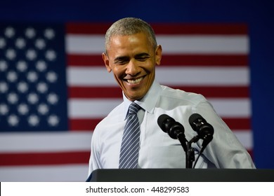 CHARLOTTE, NC, USA - JULY 5, 2016: President Barack Obama laughs as he delivers a speech at a rally for the presumptive democratic nominee at the Charlotte Convention Center.