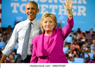 CHARLOTTE, NC, USA - JULY 5, 2016: President Obama and Hillary Clinton wave to the crowd on stage at their first campaign appearance at the Charlotte Convention Center.